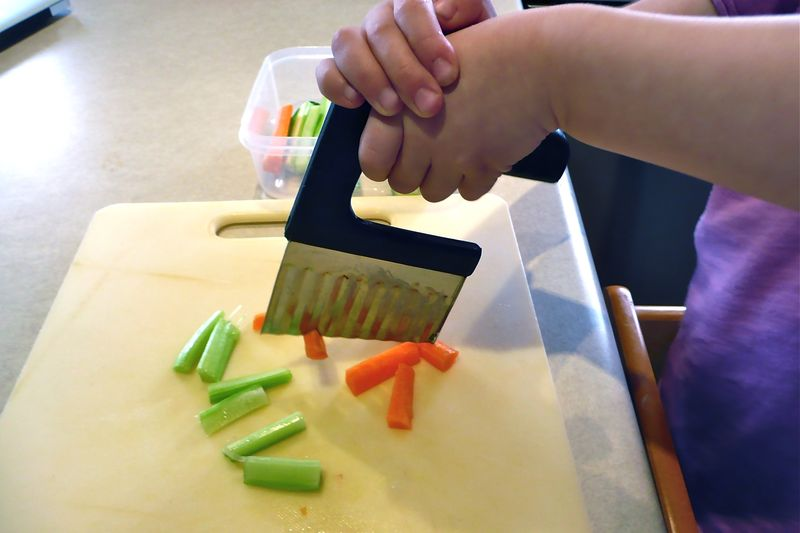 Kids Cutting (Photo from How We Montessori)