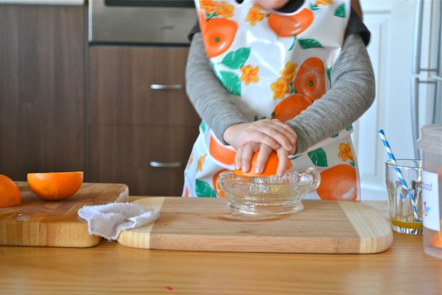 Juicing Oranges (Photo from How We Montessori)