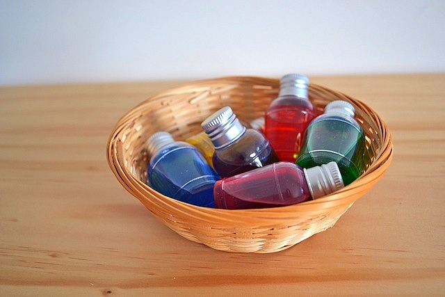 Little colour bottles in small basket