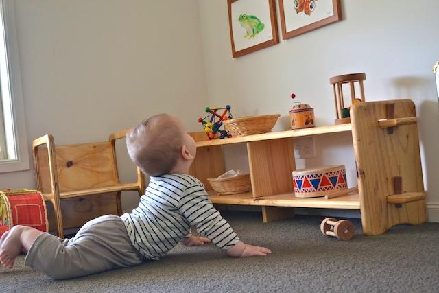 Ot looking at pictures. how we montessori  Otis s Montessori room