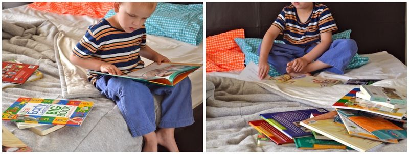 Caspar reading books on bed