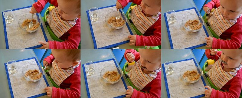 Otis eating breakfast with a spoon at twelve months