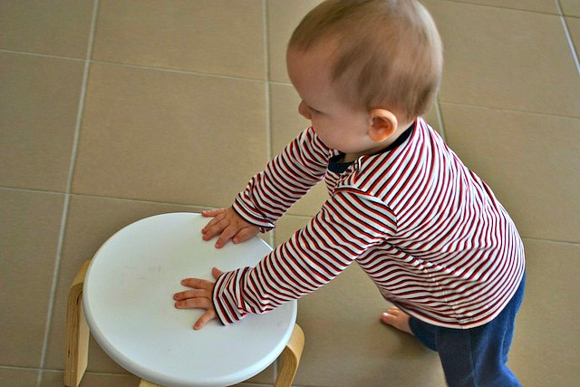 Otis walking with stool - 12 months