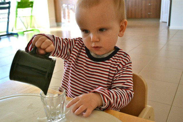 Pouring a drink at 13 months.