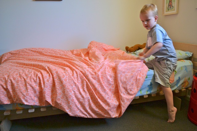 Caspar making bed 2
