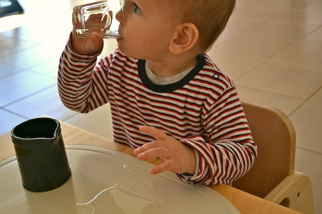 Otis drinking from glass at 13 months