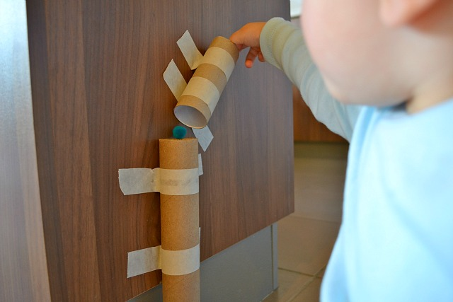 Small pom pom through cardboard tubes