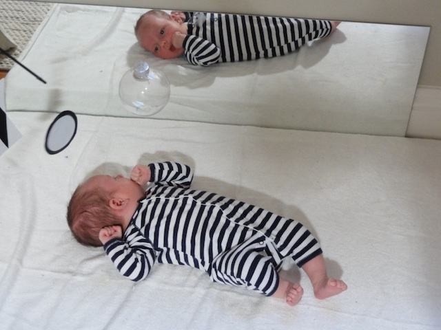 Miles at 3 weeks looking in mirror (with Munari Montessori mobile)