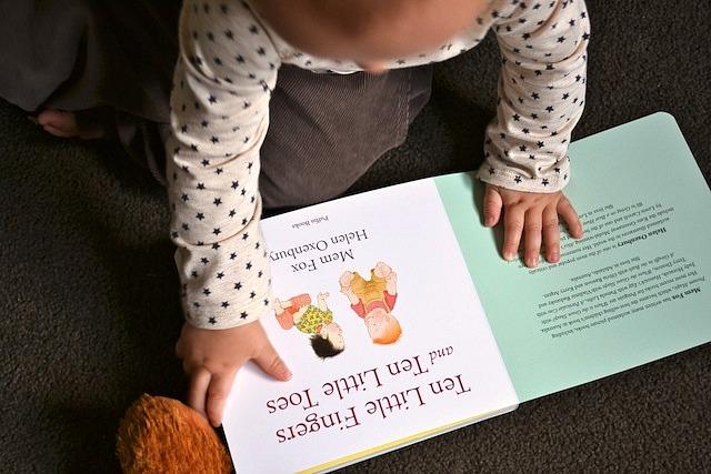 Otis reading Ten Little Fingers Ten Little Toes