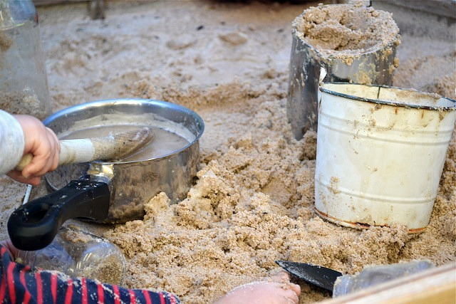 Otis with pot, jug and bucket in sand pit