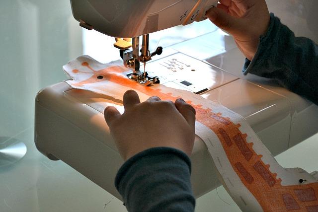 Caspar using sewing machine