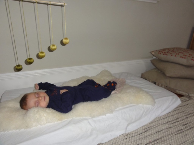 Miles sleeping under Gobbi mobile - a traditional Montessori mobile